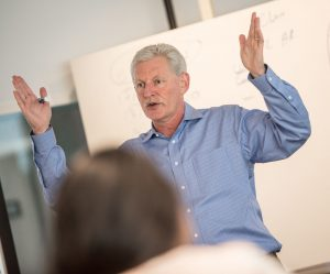 professor teaching in classroom